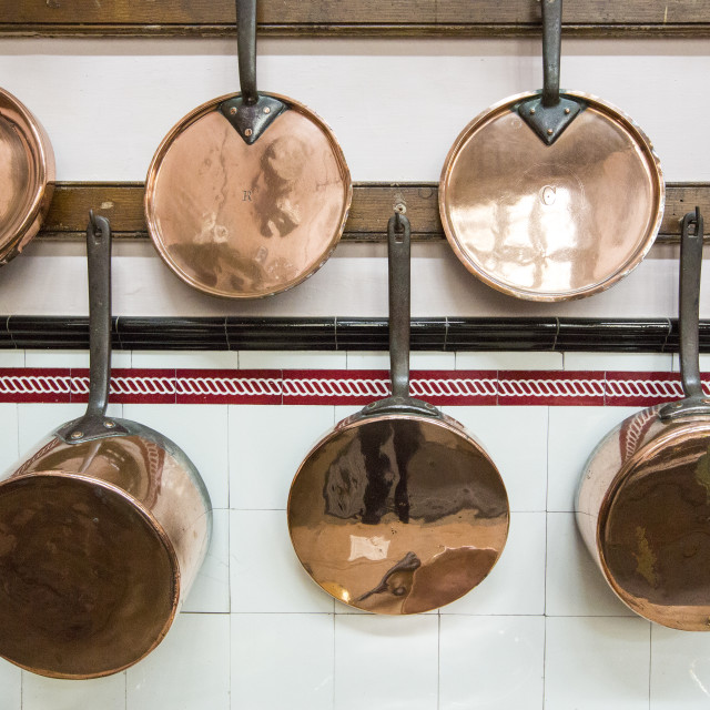"""Copper pots and pans in the kitchen at Lanhydrock a country residence dating..."" stock image"