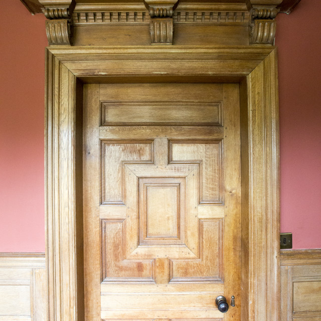 """A wooden door and surround at Lanhydrock a country residence dating from the..."" stock image"