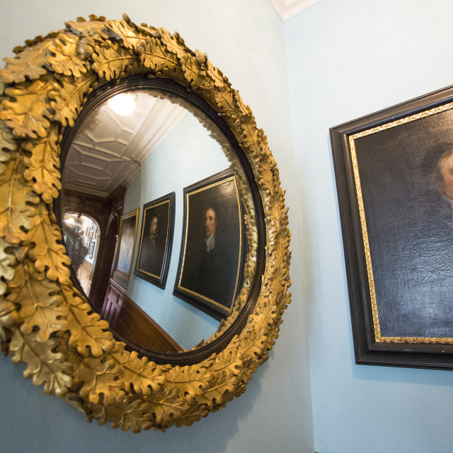 """A Victorian mirror and paintings at Lanhydrock a country residence dating..."" stock image"