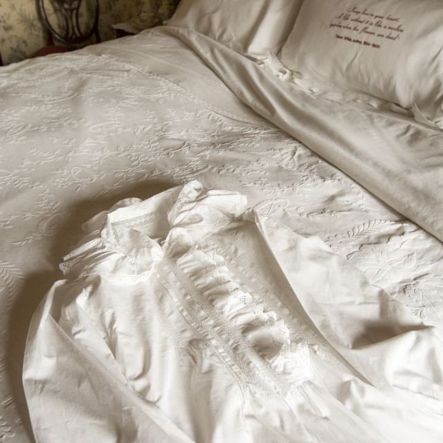 """Antique ladies bed clothes at Lanhydrock a country residence dating from the..."" stock image"