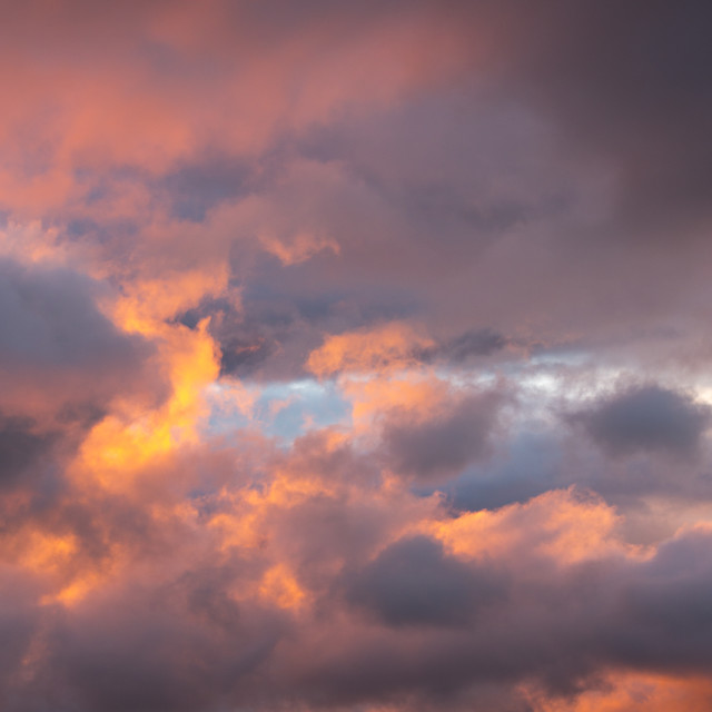 """""""A shaft of light streaks through a gap in storm clouds at sunset, causing a..."""" stock image"""