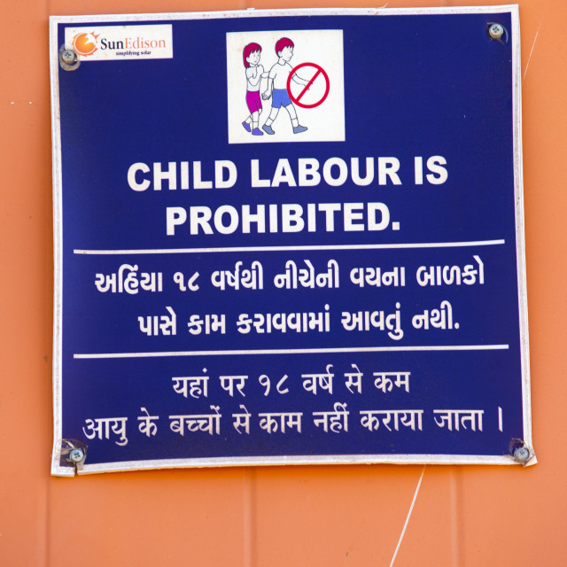 """""""A sign banning child labour at Asia's largest solar popwer station, the..."""" stock image"""