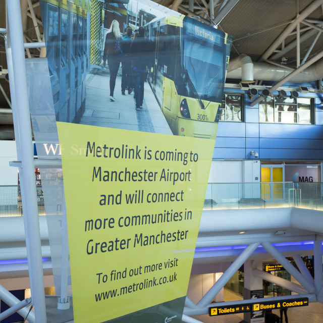 """""""An advert for the extension of the Metrolink tram system at Manchester..."""" stock image"""