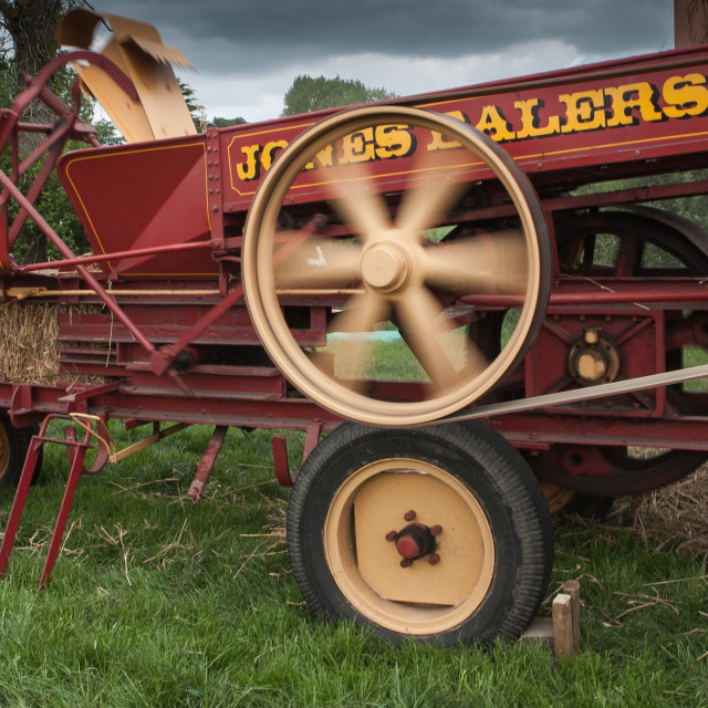 """Old time hay baler"" stock image"