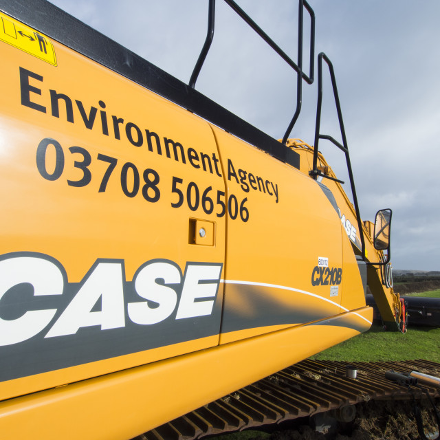 """A digger being used by the Environment agency to dredge out ditches behind..."" stock image"
