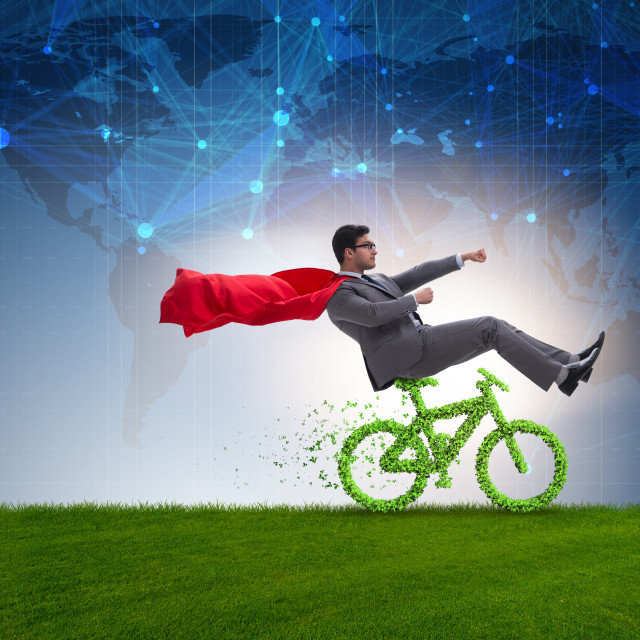 """Green bycycle in environmentally friendly transportation concept"" stock image"