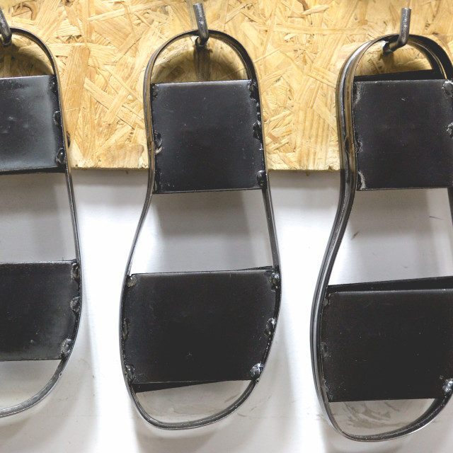 """""""Metal black shoe forms hanged on wall"""" stock image"""