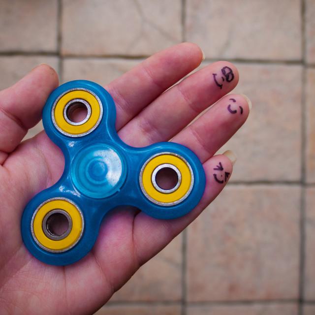 """""""Motionless Fidget Spinner in Hand"""" stock image"""