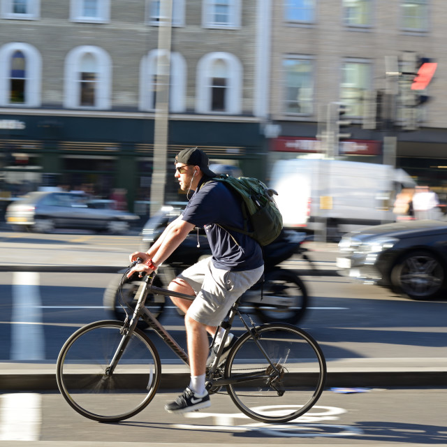 """Young man riding a bike"" stock image"