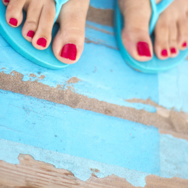 """Lady's feet in sandals on beach"" stock image"