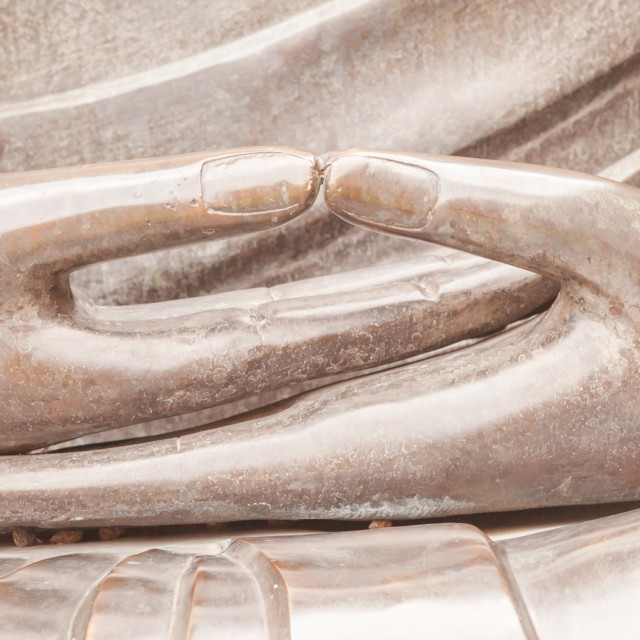 """""""Detail of Buddha statue with Dhyana hand position, the gesture of meditation"""" stock image"""