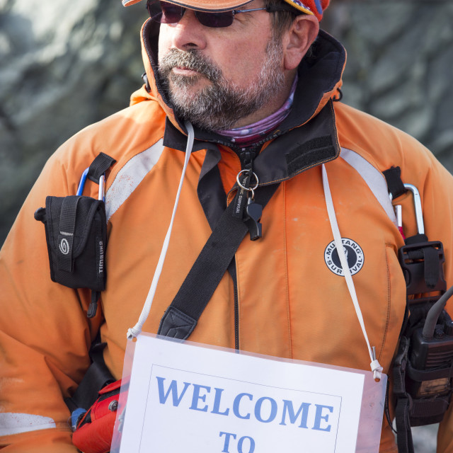 """An Antarctic expedition cruise leader wearing a welcome to Antarctica sign..."" stock image"
