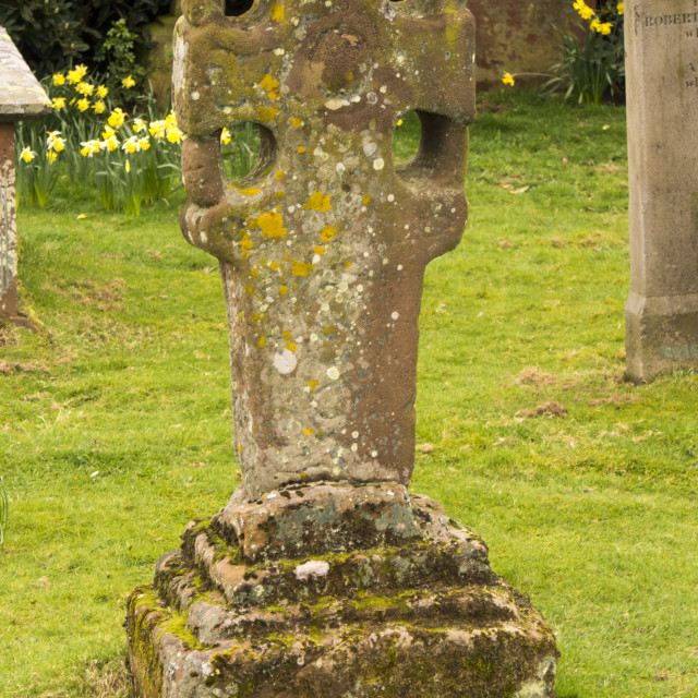 """""""An ancient stone cross in the grave yard of the Church of St. Michael;..."""" stock image"""