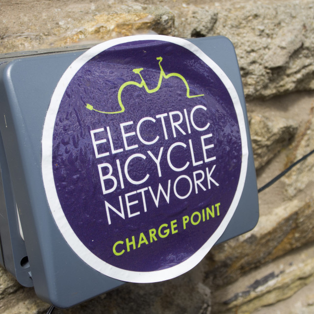 """An electric bike recharging point at a cafe in tosside in the Forest of..."" stock image"