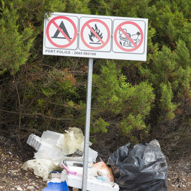 """""""The irony of litter being left below a no litter sign in Sivota, Greece."""" stock image"""