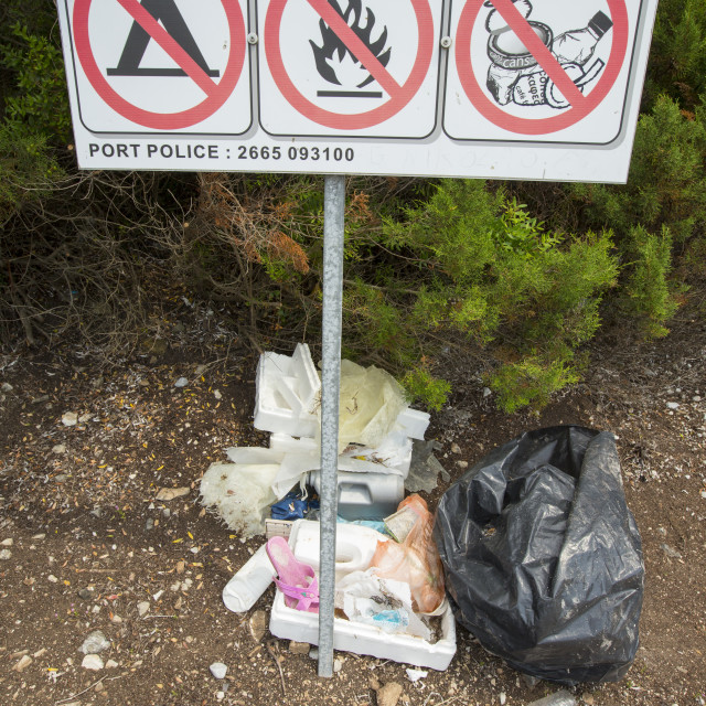 """""""The irony of litter dumped next to a no littering sign on an island off..."""" stock image"""