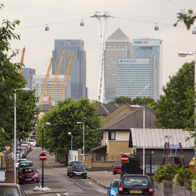"""""""Canary Wharf and the Emirates air line cable car from a city back street,..."""" stock image"""