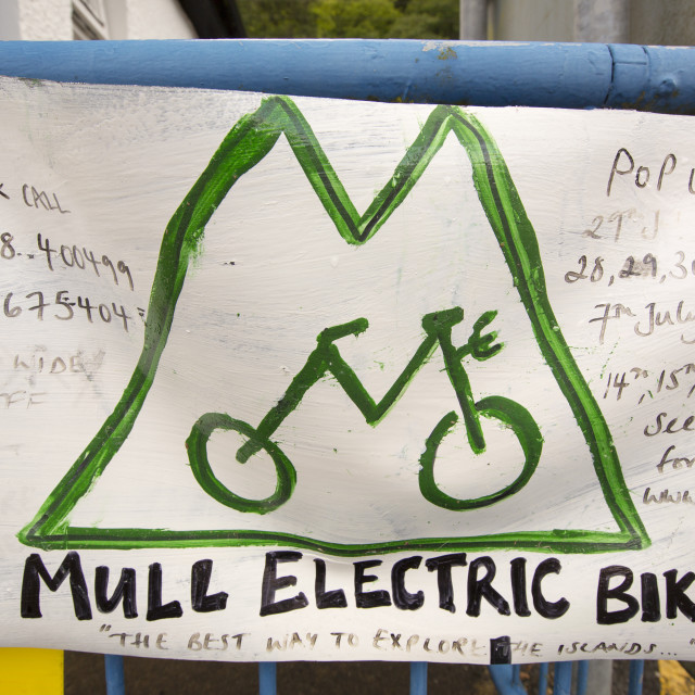 """An electric bike hire sign on the Isle of Mull, Scotland, UK."" stock image"