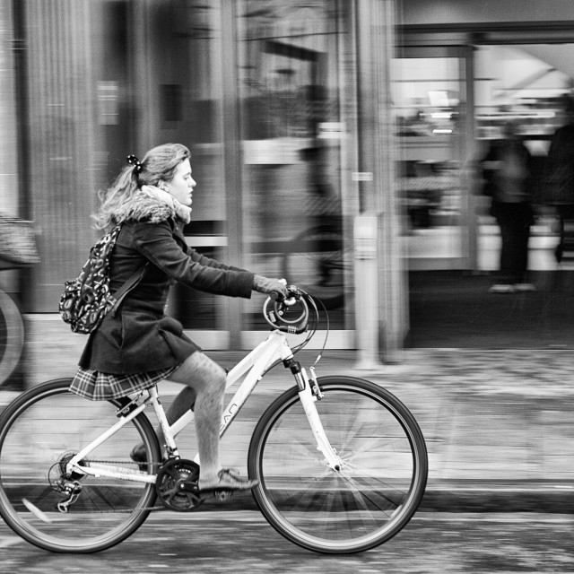 """""""Young Lady on a bike"""" stock image"""