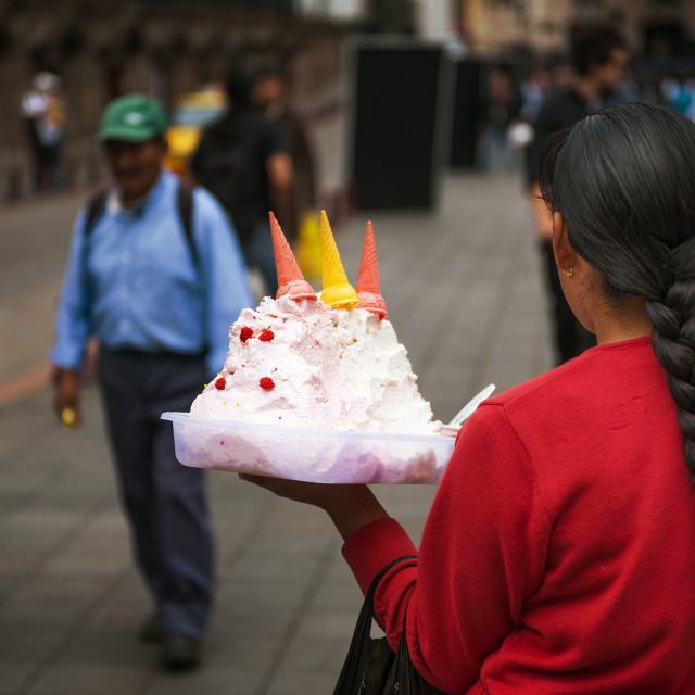"""Quito, Ecuador - January 29, 2014: Local woman selling ice cream in a street of the city of Quito, in Ecuador"" stock image"