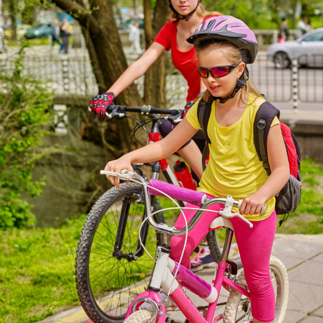 """""""Family bike ride. Family wearing bicycle helmet with rucksack ."""" stock image"""