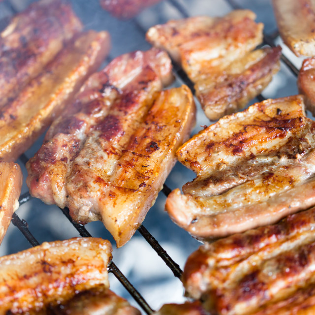 """Grilled pork belly, bacon on hot grate close up"" stock image"
