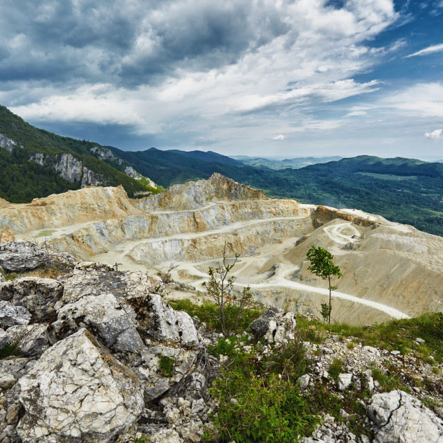 """Stone quarry in the mountains"" stock image"