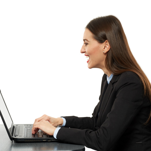 """""""Amused business woman laughing reading on laptop"""" stock image"""