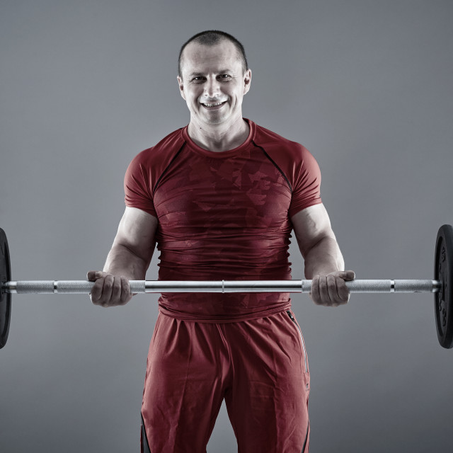 """""""Fitness man doing biceps curl with barbell"""" stock image"""
