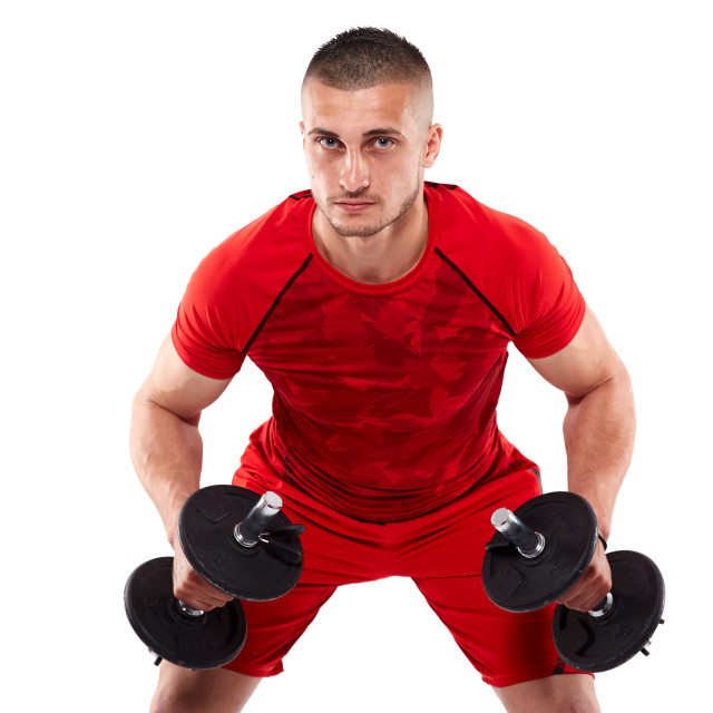 """""""Young man doing shoulder workout"""" stock image"""