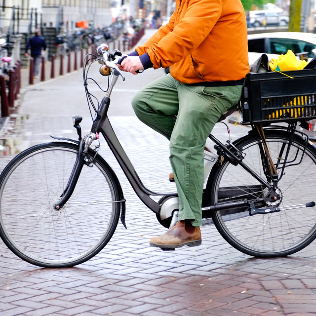 """lower half of cyclist in amsterdam cycling"" stock image"