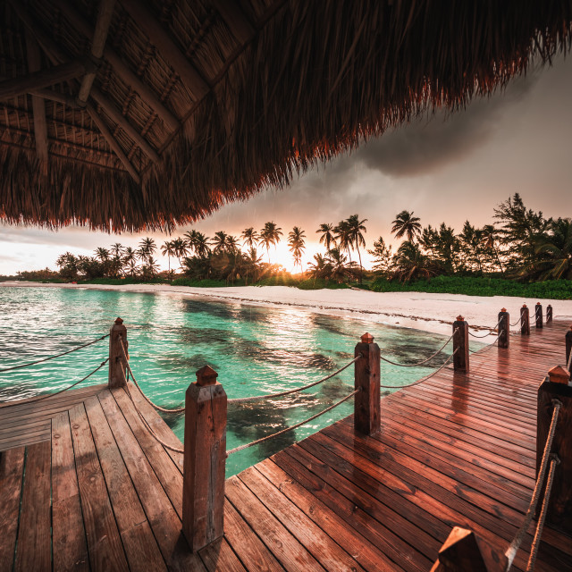 """Beautiful view toward tropical beach from wooden water villa"" stock image"
