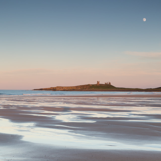 """Dunstanburgh Moon"" stock image"