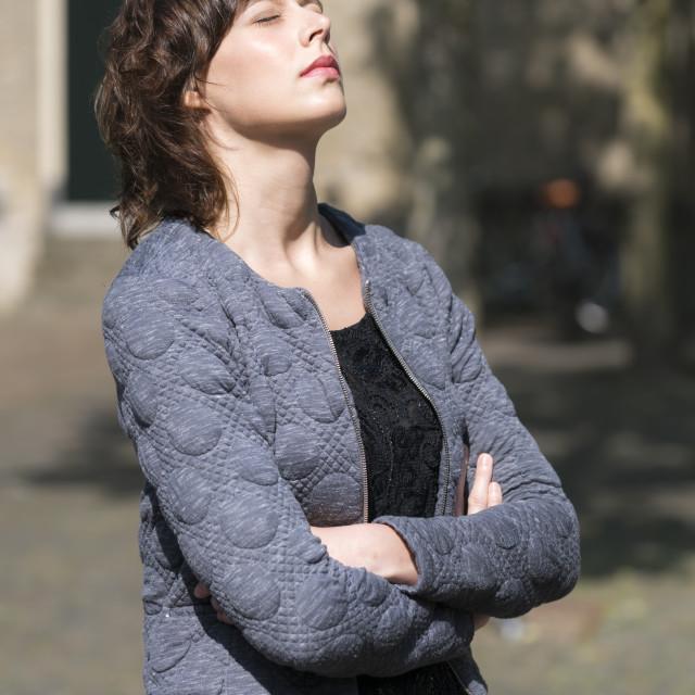 """Enjoying sunlight in an urban setting"" stock image"