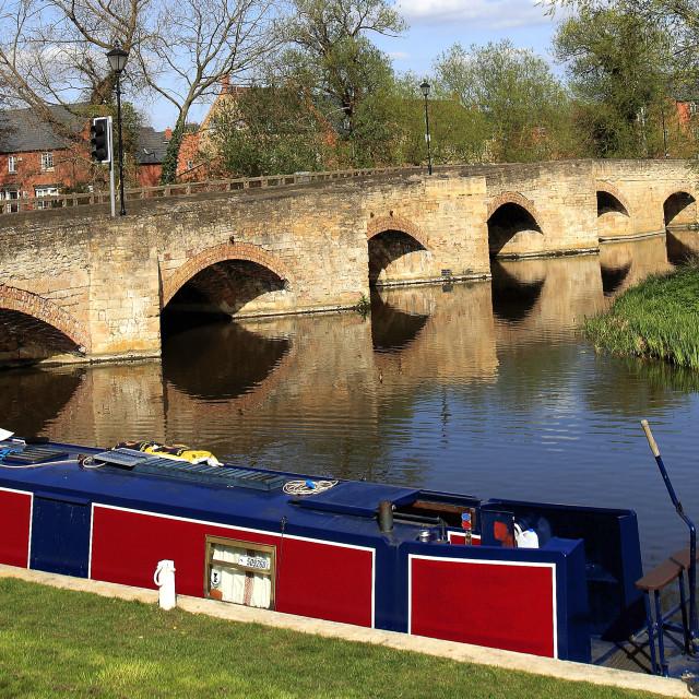 """Narrowboat and bridge over the river Nene, Islip town, Northamptonshire,..."" stock image"