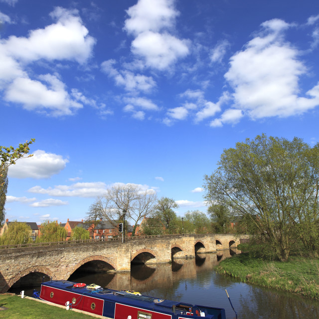 """Narrowboat and bridge over the river Nene, Islip town, Northamptonshire,..."" stock image"
