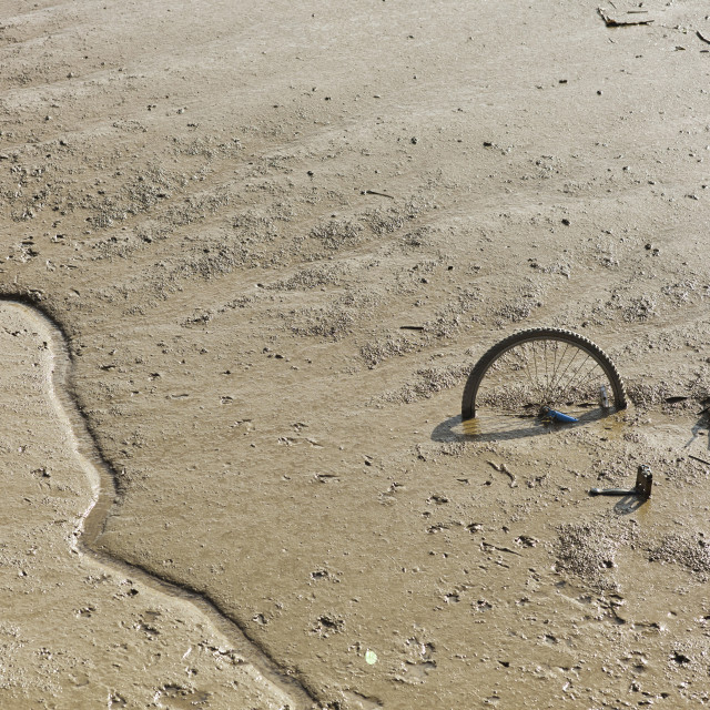 """""""Bicycle in mud of the river Hull"""" stock image"""