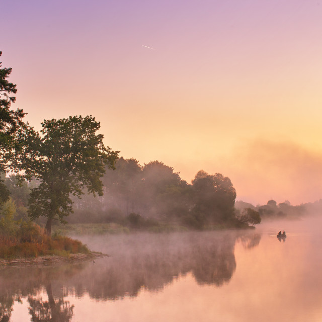 """""""Misty morning on the lake. Fishing boat at a foggy river"""" stock image"""
