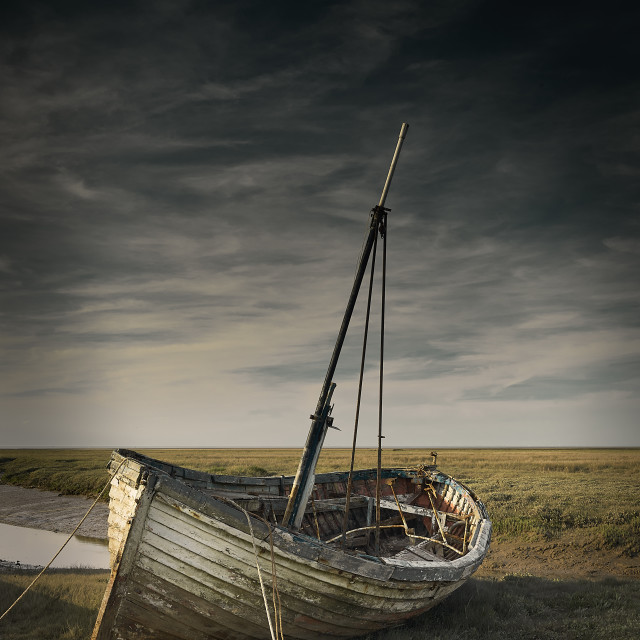 """Aging boat Thornham Harour Norfolk"" stock image"