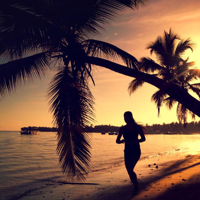 """Sea sunrise. Girl running on the tropical island beach Punta Can"" stock image"