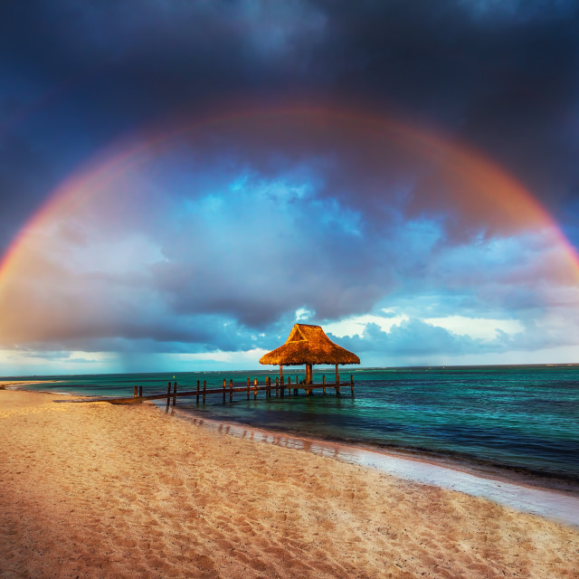 """Rainbow over the Tropical beach in Punta Cana, Dominican Republi"" stock image"