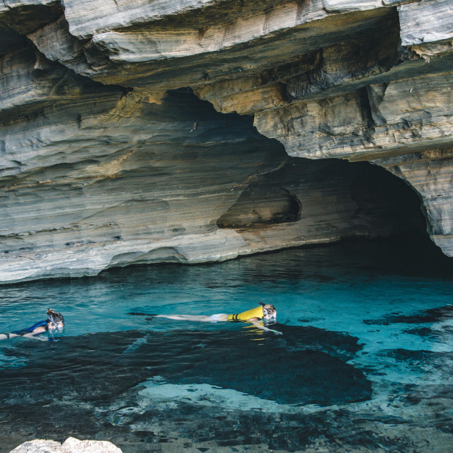 """""""Exploring the Caves"""" stock image"""