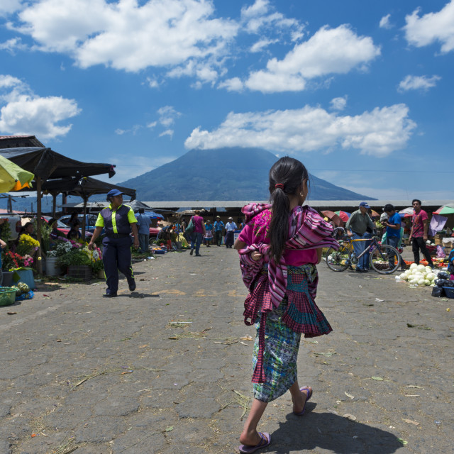 """Antigua, Guatemala - April 19, 2014: Local girl wearing traditional clothing in a street market in the city of Antigua, in Guatemala, Central America"" stock image"