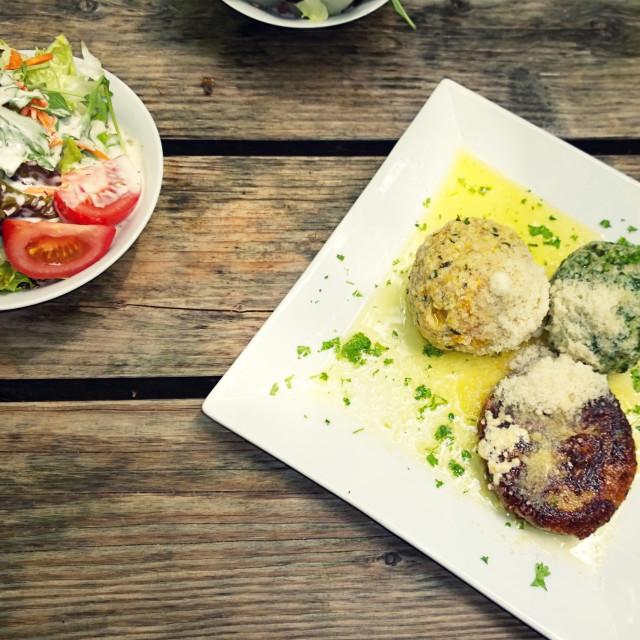 """Bavaria, beer garden food outdoor:bread dumplings with butter sauce and mixed..."" stock image"