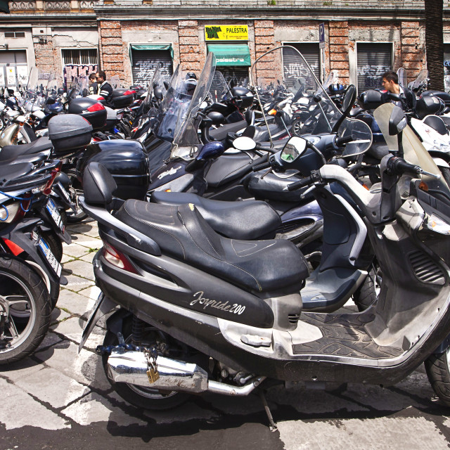 """Genoa, Italy- scooter parking in city center"" stock image"