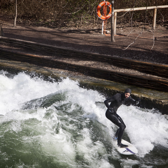 """Winter surfing on the Eisbach river at Englischer Garden in Munich"" stock image"