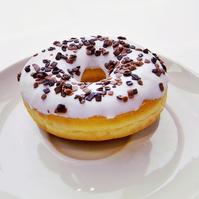 """Donut with vanilla white glaze and chocolate sprinkles"" stock image"