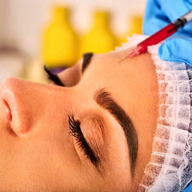 """Filler injection for forehead face. Plastic aesthetic facial surgery ."" stock image"