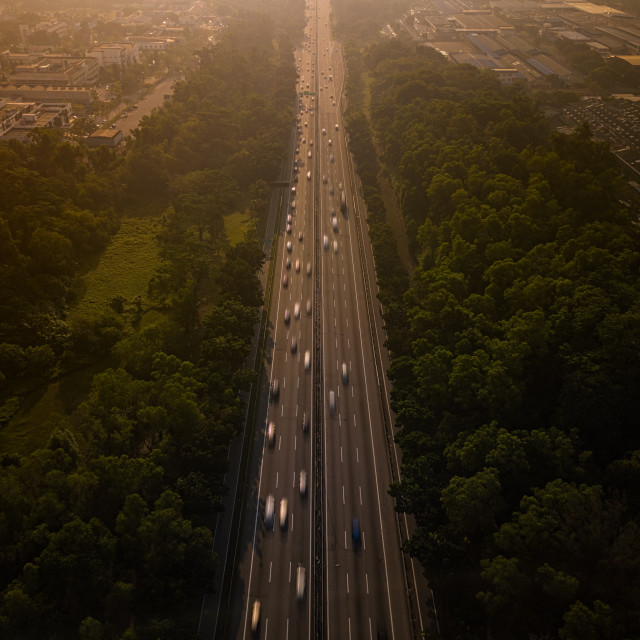 """Aerial Photo - Traffic building up on the road at sunrise."" stock image"
