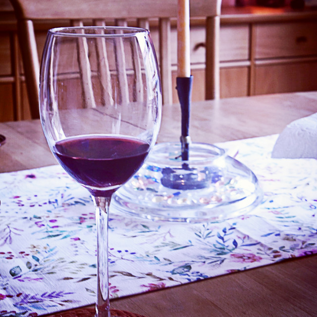 """Red wine glass on the table, blurred background"" stock image"